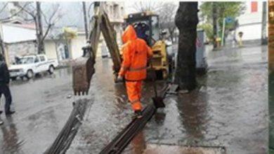 تصویر از تلاش نیروهای خدمات شهری شهرداری رشت برای رفع آبگرفتگی